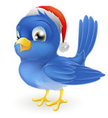 Blue bird in Santa Claus hat — Vetor de Stock