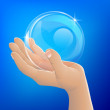 Stock Vector: Hand holding bubble or glass ball