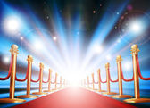Grand entrance with red carpet and flash lights — Stockvector