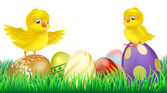 Cute yellow chicks on Easter eggs — Stock Vector