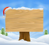 Christmas Santa hat sign background — Stock Vector