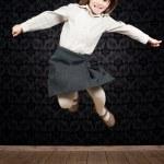 Little girl jumping — Stock Photo #8756410