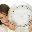 Little girl behind clock — Stock Photo #9054596