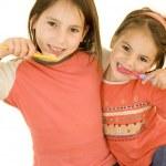 Two girls brushing his teeth — Stock Photo