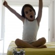Little girl on the bed — Stock Photo
