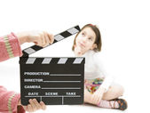 Little girl with a clapperboard — Stock Photo