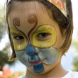 Little girl with butterfly make-up — Stock Photo