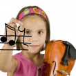 Little girl writing with a pen and holding a violin — Stock Photo #9125946