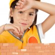 Little girl building a wall isolated on white background — Stock Photo