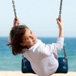 Little girl swinging — Stock Photo