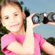 Girl with binoculars — Stock Photo #9130989
