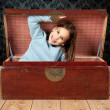 Royalty-Free Stock Photo: Little girl inside an ancient trunk