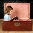 Little girl reading a book — Stock Photo #9173251