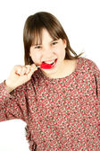 Young girl with lollipop — Stock Photo