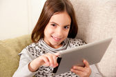 Little girl with touch tablet computer — Stock Photo