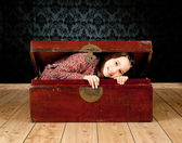 Young girl inside an ancient trunk — Stock Photo