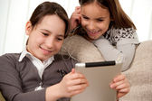 Two girls with touch tablet computer — Stock Photo