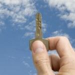 Hand holding a key — Stock Photo