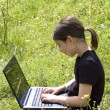 Young girl with laptop — Stock Photo