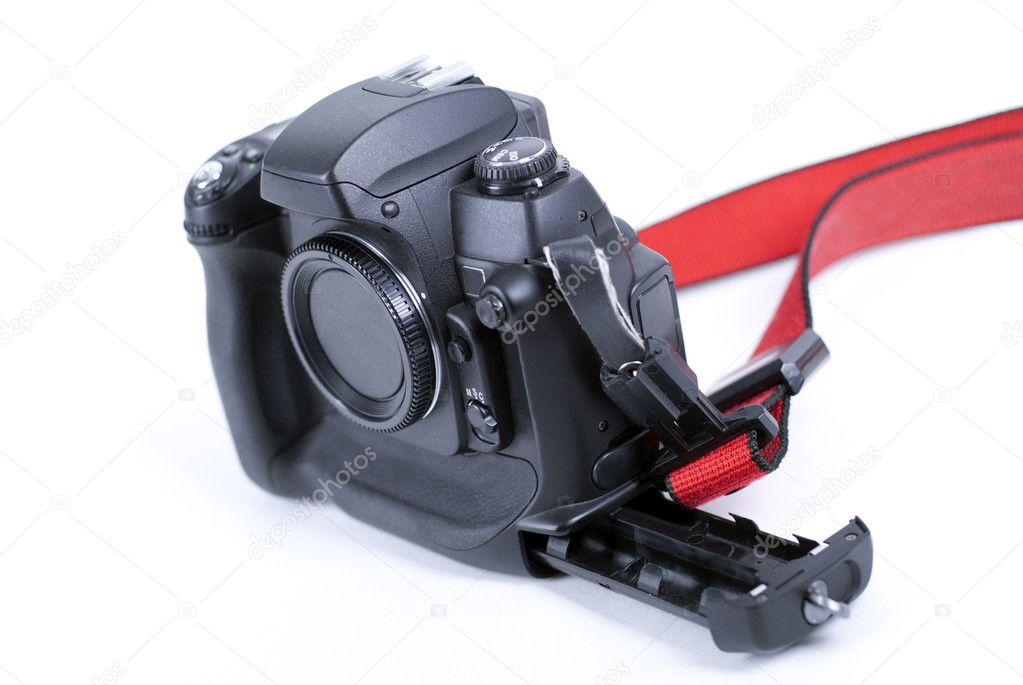 Digital camera with open battery tray and red strap on white background — Stock Photo #8934128