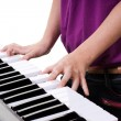 Royalty-Free Stock Photo: Close up of young girl  playing keyboard