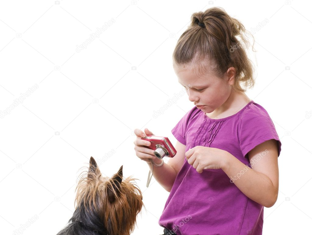 Preteen girl taking photo of pet dog isolated on white — Stock Photo #10186759