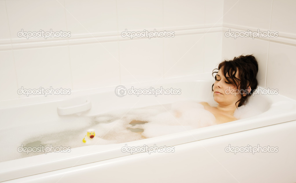 Woman in bath with ruber duck — Stock Photo #10348538