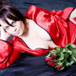Woman and roses - Foto Stock