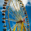 Funfair park on blue sky background — Stock Photo