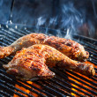Flames frying chicken on the grill — Stock Photo
