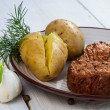 Roast beef steak served with potatoes and dill — Stock Photo