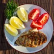 Roasted grilled chicken breast served with tomatoes — Stock Photo #10448417