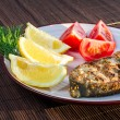 Fried fish served on plate with vegetables — Stock Photo #10448421