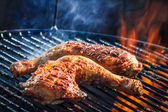 Roast chicken leg on grill — Stock Photo