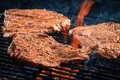 Roast steak beaf on grill — Stock Photo