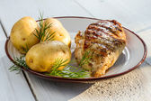 Roasted chicken breast served with potatoes and dill — Stock Photo