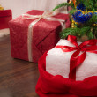 Closeup red present under christmas tree — Stock Photo