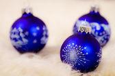 Tree blue christmas glass bulb on white background — Stock Photo