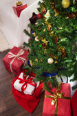 Four gifts with christmas tree in xmas — Stock Photo