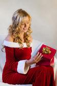 Beautiful woman opening christmas gift — Stock Photo