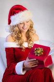 Beautiful woman enjoying christmas present — Stock Photo