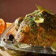 Roasted chicken in casserole dish with herbs — Stock Photo
