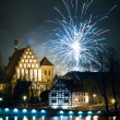 Stock Photo: Sparklers over river at night