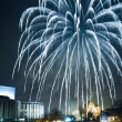Stock Photo: Firecrackers over river at night