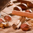 Closeup all sorts of nuts on wooden bamboo mat — Stock Photo