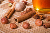 Honey jar and all sorts of nuts — Stock Photo