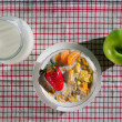 Fresh fruits and corn flakes with milk — Stock Photo #8757643