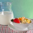 Fresh fruits with corn flakes and milk jug — Stock Photo #8757651