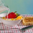 Milk and fresh fruit with corn flakes — Stock Photo