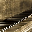 Old vintage piano in sepia toned — Stock Photo